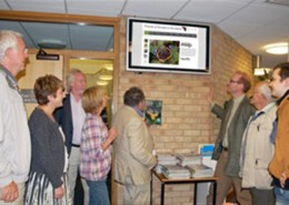 Members of the committee view the new website with the  web developer Peter Smith (far right).